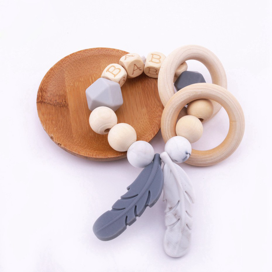 Bite Bites 1PC Food Grade Silicone Feather Teether Chewing Custom Bracelet Baby Care Products Wooden Teething Ring Baby Teether
