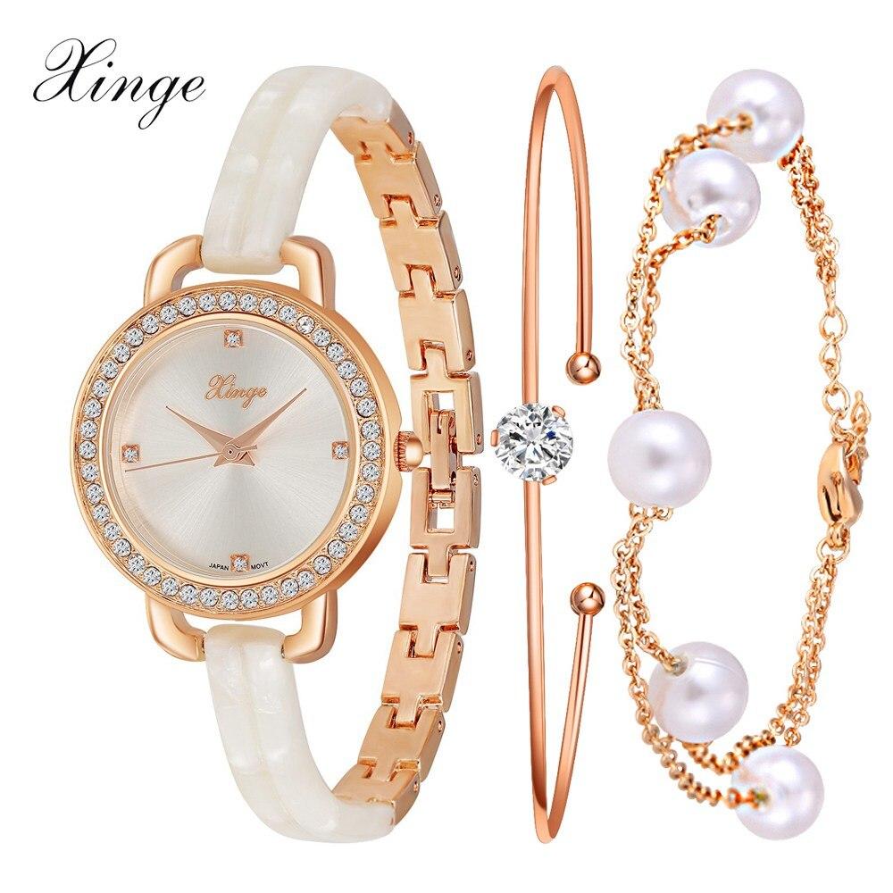 Prix pour Xinge montre de luxe femmes marque de mode or cristal bracelet quartz montres femmes perle robe bijoux montre électronique