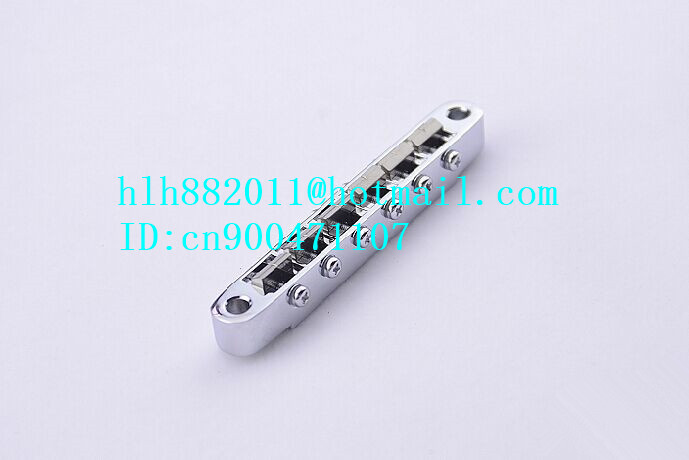 free shipping new  electric guitar titanium bridge for one piece  TI-104B  LH-09 free shipping new electric bass guitar string retainer for one piece xz 8147