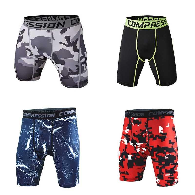 Ropa de compresión para el gimnasio deportiva para hombres bajo la capa Base pantalones cortos medias atléticas medias Pantalones