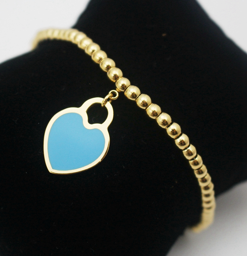 c3b7a766e0a83 Regalo di natale in acciaio inox dello smalto del cuore della pesca  bracciale in oro per amore femme ragazza buona fortuna braccialetto di  fascino diy best ...