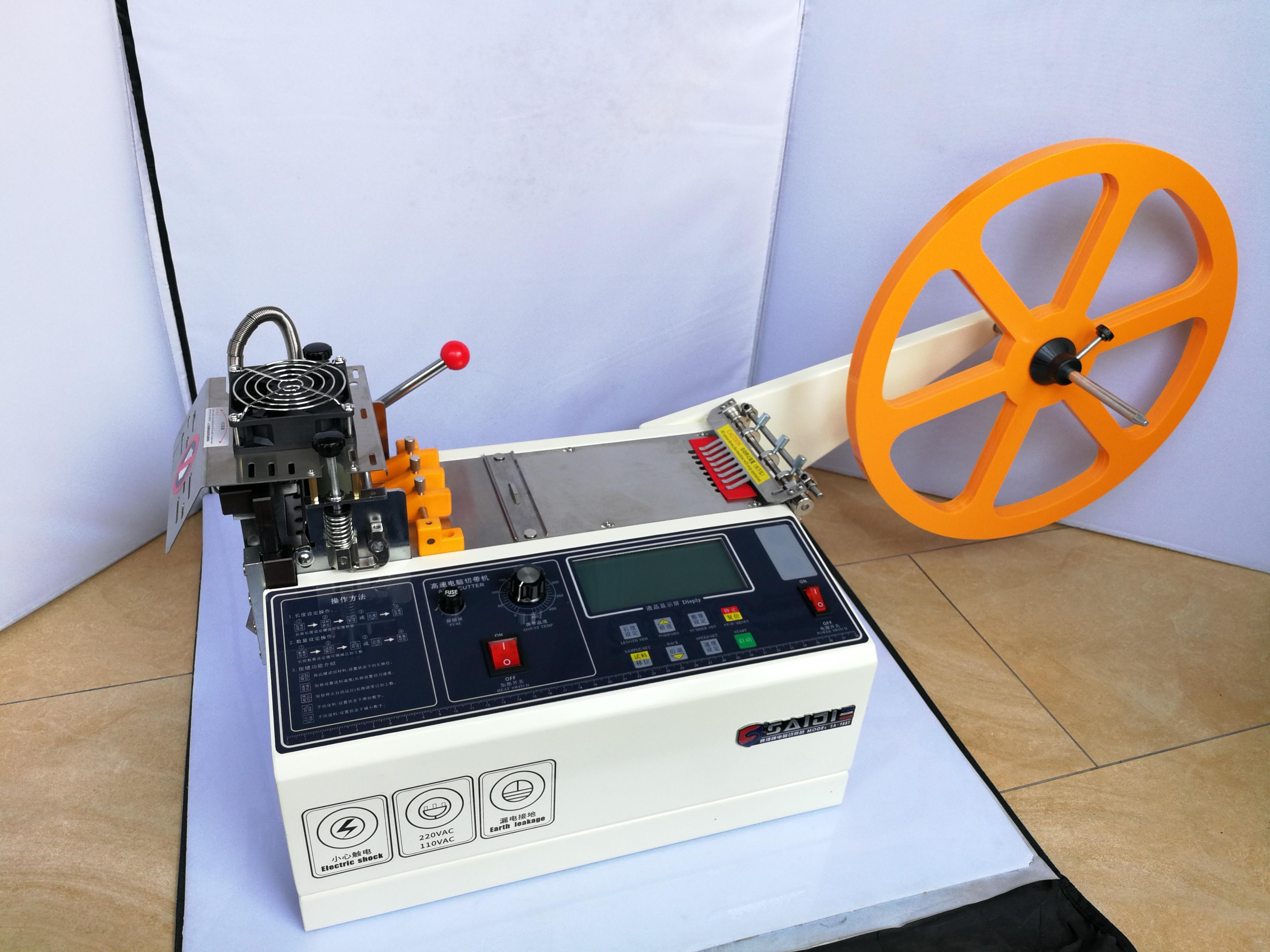 Découpeuse automatique de ceinture de tissu chaud et froid de l'ordinateur 988 T, coupe élastique magique de ceinture de machine de sangle de tirette de bande adhésive