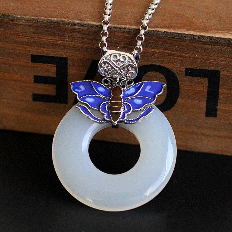 Personnage argent produit argent brûlé bleu papillon noeud femmes paix boucle couleur pendentif