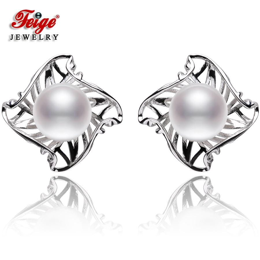 f526a90fe990 Nuevo diseño 925 plata esterlina Pendientes de broche para la boda de la  señora Joyería fina regalos 9-10mm blanco perla de agua dulce Pendientes  feige