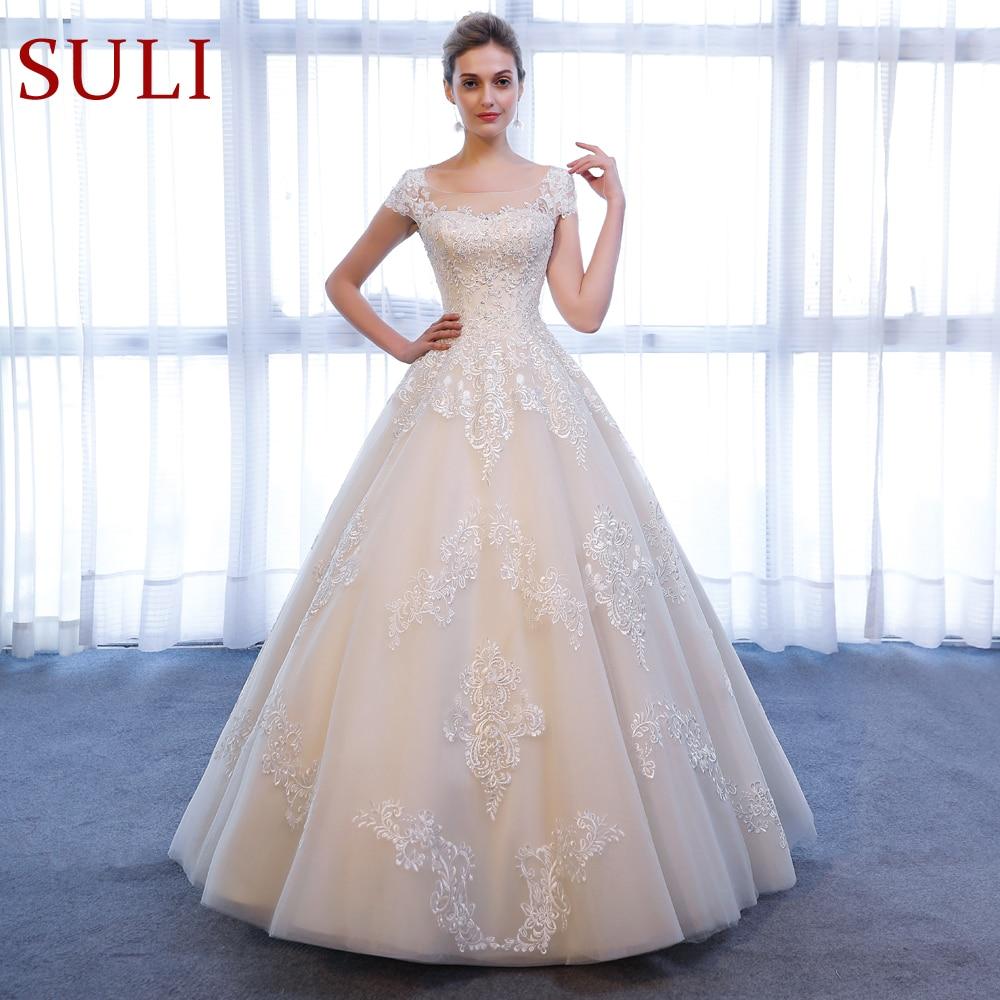 SL 307 Charming A Line Short Sleeve Lace Appliques Beach Vintage SuLi Wedding Dress 2018