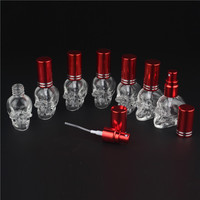 100pcs 10 Colors 8ML Mini Fashion Skull Glass Perfume Bottle Empty Clear Atomizer Spray Bottle Refillable Perfume Packaging