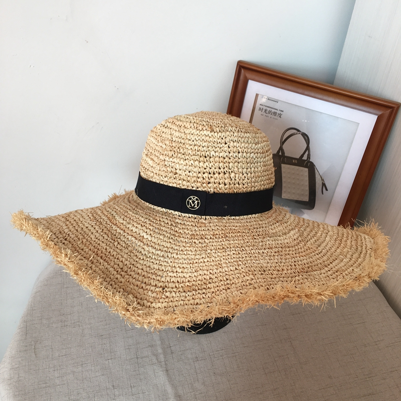 Han edition lafite grass beach hat female summer beach sun hat M wide brim  holiday travel is the bowknot straw hat-in Sun Hats from Apparel  Accessories on ... 97e66e2af2e0