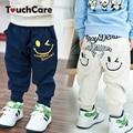 Linda sonrisa pantalones deportivos sueltos boy pantalones harén bebé pantalones niños pantalones niños pantalones casuales pantalones largos pantalones de la colmena