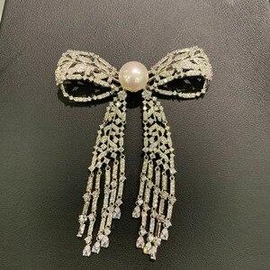 Image 3 - 11 12 ミリメートル天然淡水真珠のブローチ銅立方ジルコンちょうブローチピンタッセル古典的なファッション女性ジュエリー