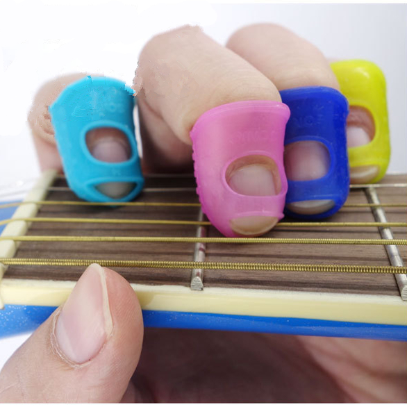 5pcs Silicone Guitar Thumb Finger Picks Protector Plectrum Fingertip thimble Finger Guard safety protect caps Colors Random soach 16pcs pvc guitar picks pictures random black picks bag package holder bass guitar part