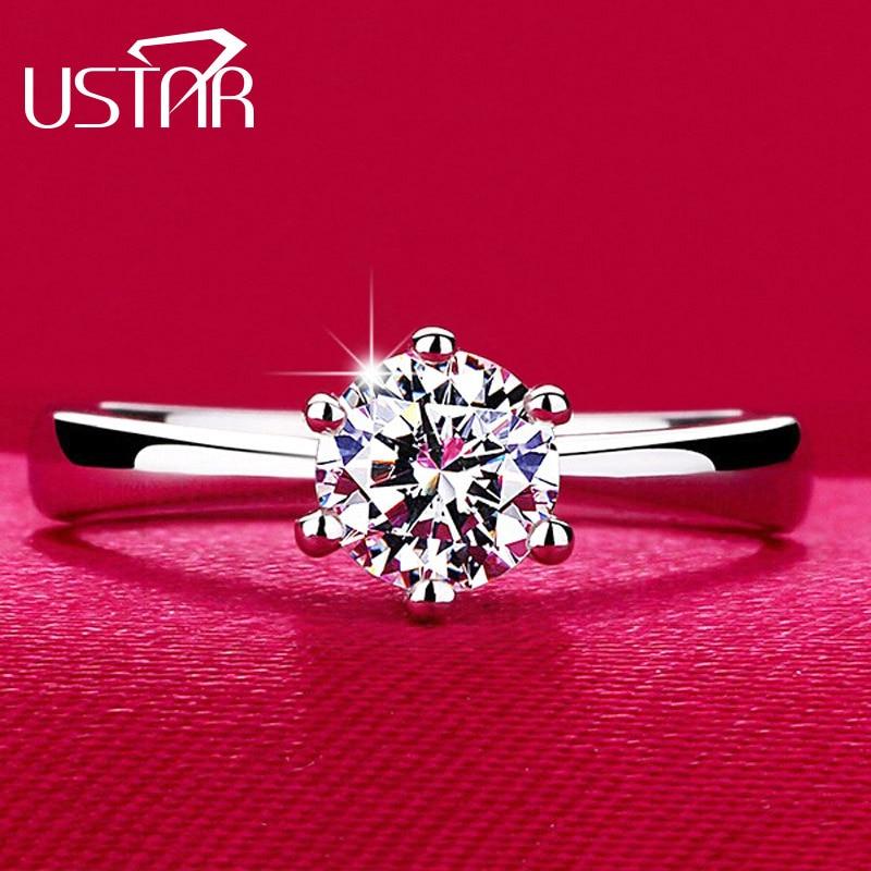Купить на aliexpress USTAR классические шесть крапанов 1 карат 6 мм циркон обручальные кольца для женщин ювелирные изделия серебристого цвета женские кольца для по...