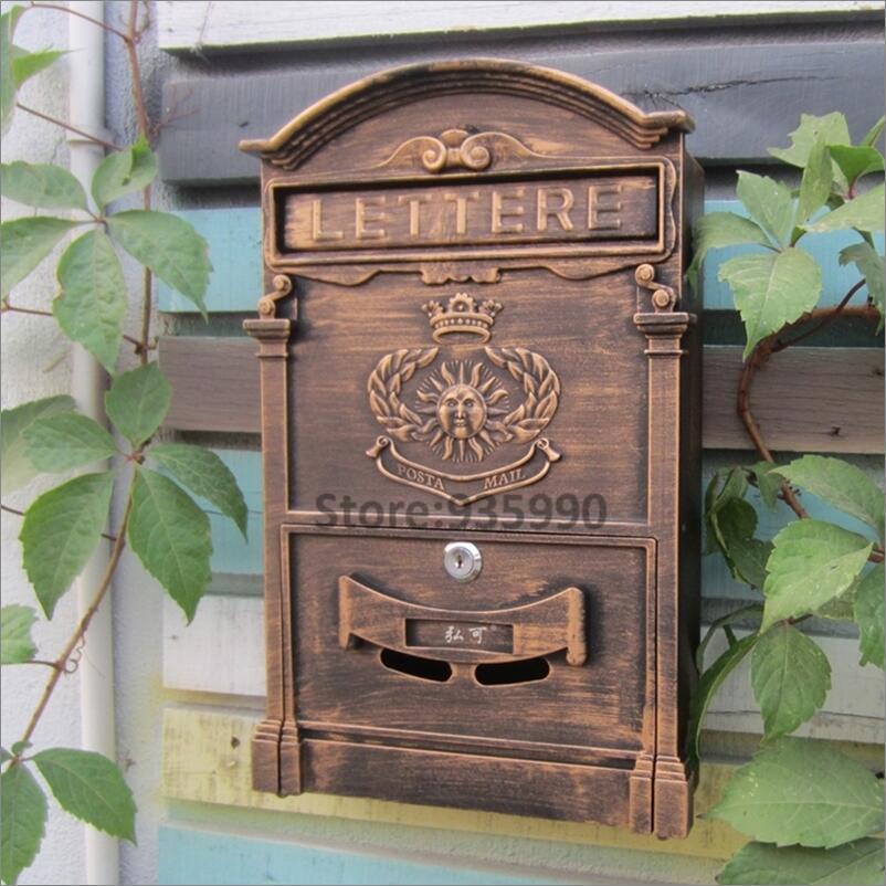 Pattern bronze vintage rustic iron mailbox sungod sign newspaper pattern bronze vintage rustic iron mailbox sungod sign newspaper mailboxes golden post box letter box waterproof home decoration in mailboxes from home spiritdancerdesigns Gallery