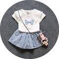 2016 conjuntos de roupas de bebê roupas de bebê de Algodão roupas de verão arco borla T-shirt + saias florais 2 pcs recém-nascidos terno casaco infantil