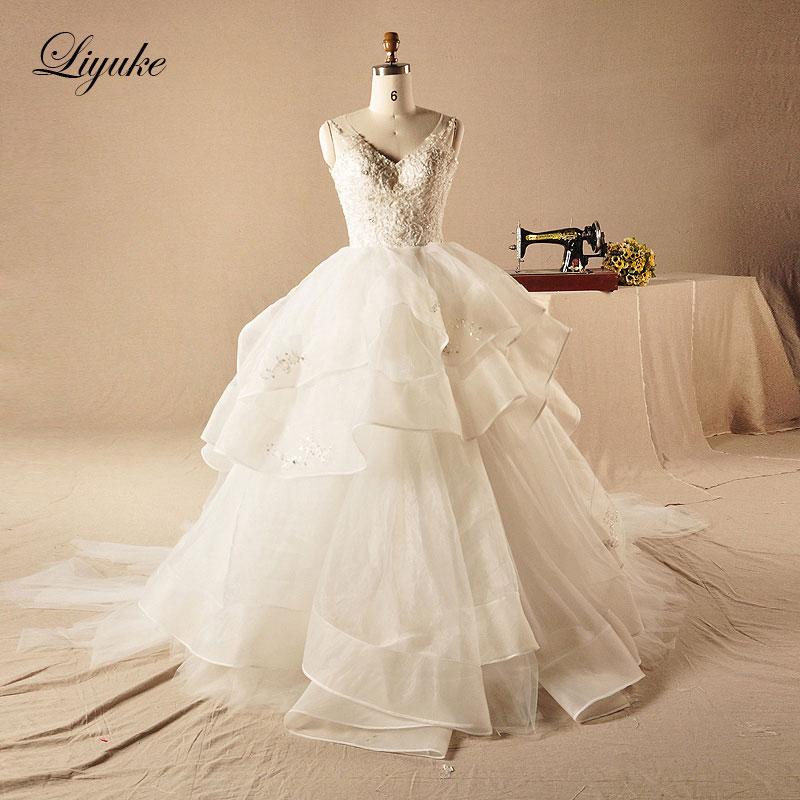 Luxurious Satin V-Neckline Ball Gown Wedding Dress Appliqued Beading Court Train Bridal Dresses Liyuke Wedding Gown