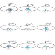 9ef385b2ab28 2018 nueva moda Zircon azul ópalo de cristal Cruz encanto pulsera ajustable  de plata de cadena de pulsera para las mujeres joyer.