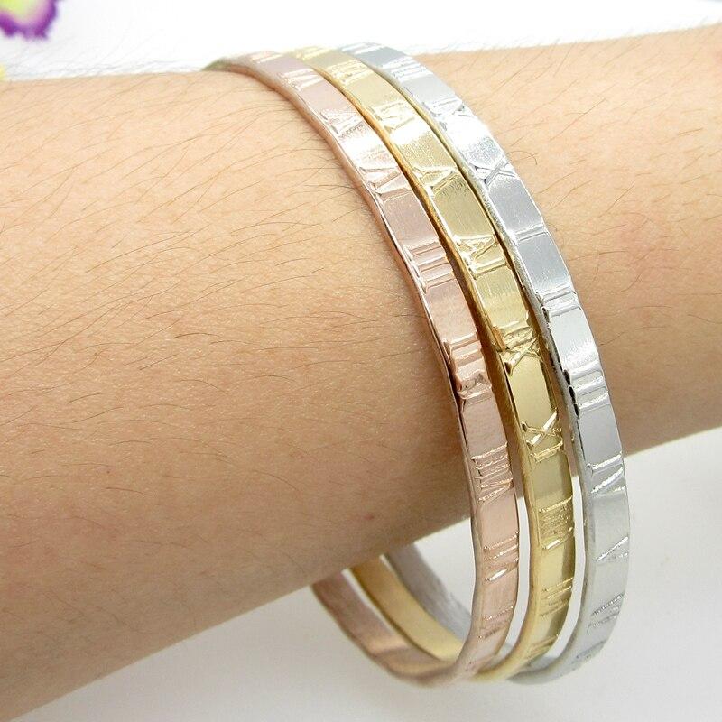 f4dba17f12f3 3 clases de Color número romano pulseras para mujeres pulseras marca moda  18 K oro acero inoxidable pulseras y brazaletes en Brazaletes de Joyería y  ...
