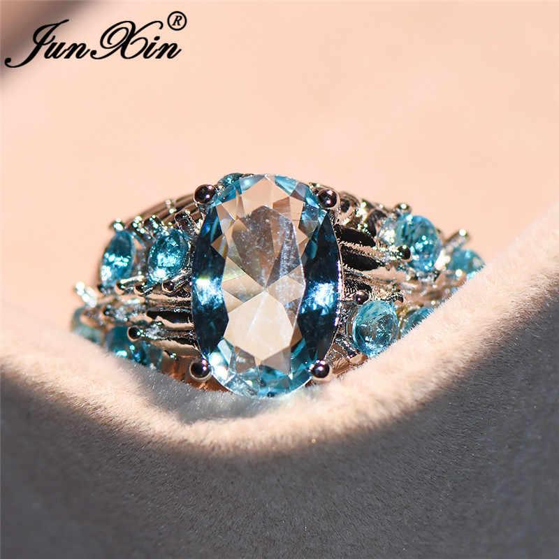 JUNXIN Boho หินสีฟ้าใส Zircon Big แหวน 925 เงินออสเตรียคริสตัล Birthstone แหวนหญิง