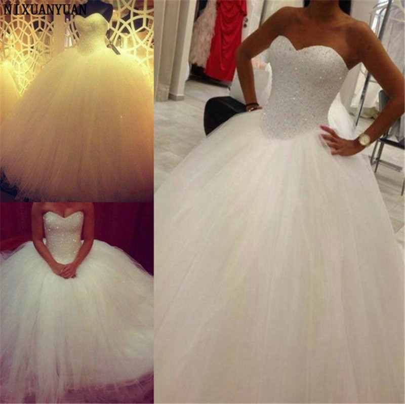 Luxury Crystal Wedding Dress 2020 New Off Shoulder Sweetheart Neckline Ball Gown Bright Lace Tulle Arab Wedding Dresses