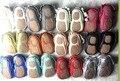 Comercio al por mayor 50 par/lote cuero genuino suela de goma dura franja arco zapatos mocasines de invierno infantil del niño del bebé zapatos de bebé de goma