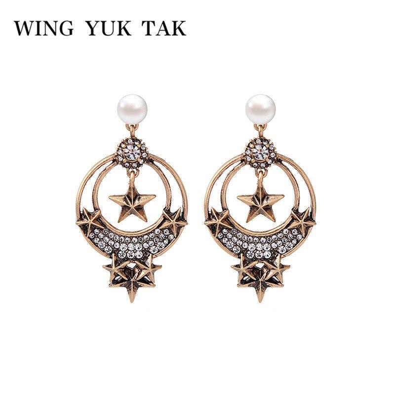 28bf87929666 Vintage Venta caliente Crystal Star Stud pendientes para la mujer encanto  simulado perla pendientes ala Yuk Tak charm joyería al por mayor en Stud ...