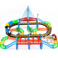 Free Shipping 128PCS Puzzle Electric Music Sound Light Track Toy Track Toy Thomas train consists of plane, train, bus, tree