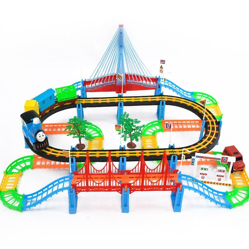 Livraison gratuite 128 pièces Puzzle électrique musique son lumière piste jouet piste jouet Thomas train se compose d'avion, train, bus, arbre