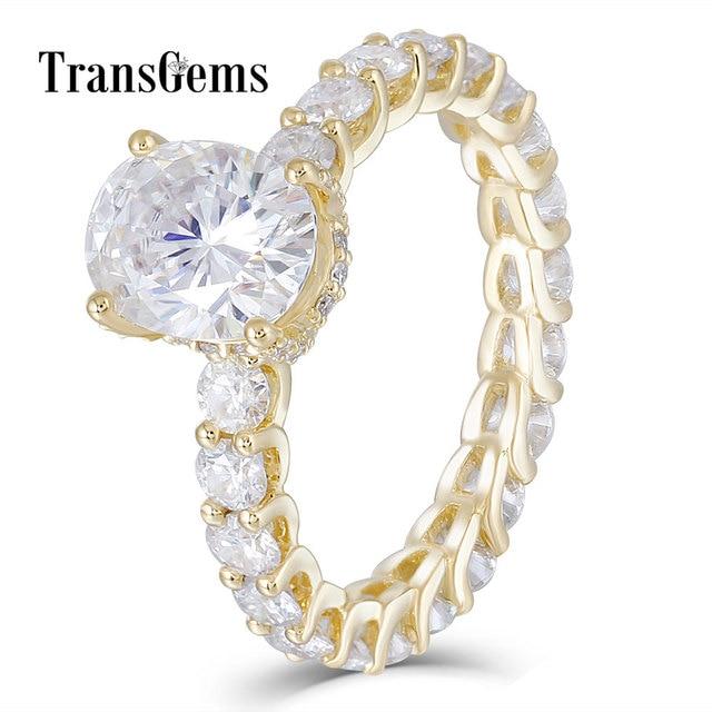 TransGems 高級 18 18K イエローゴールド 2ct 9*7 ミリメートル優れたオーバルカット F 色モアッサナイトの婚約指輪女性と永遠バンド