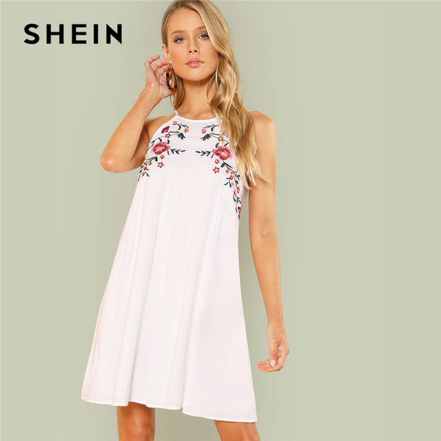 0497a06af7 SHEIN White Symmetrical Floral Embroidery Halter Trapeze Sleeveless Natural  Waist Dress Summer Women Weekend Casual Dresses