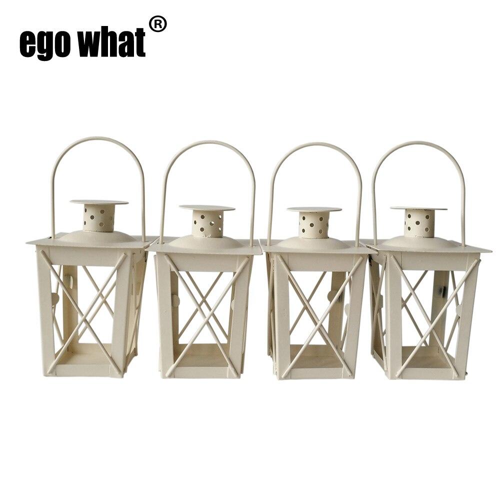 cheap 4pcs lot classic metal candle holder small iron lantern white color dans bougeoirs de. Black Bedroom Furniture Sets. Home Design Ideas