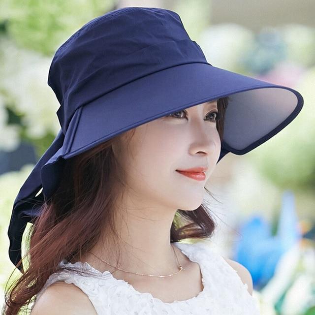 f7a8de8bc24 100PCS LOT Fashion large brimmed sun hats Foldable womens sunhats Bow  women s hat Summer Beach Floppy Cap Headwear