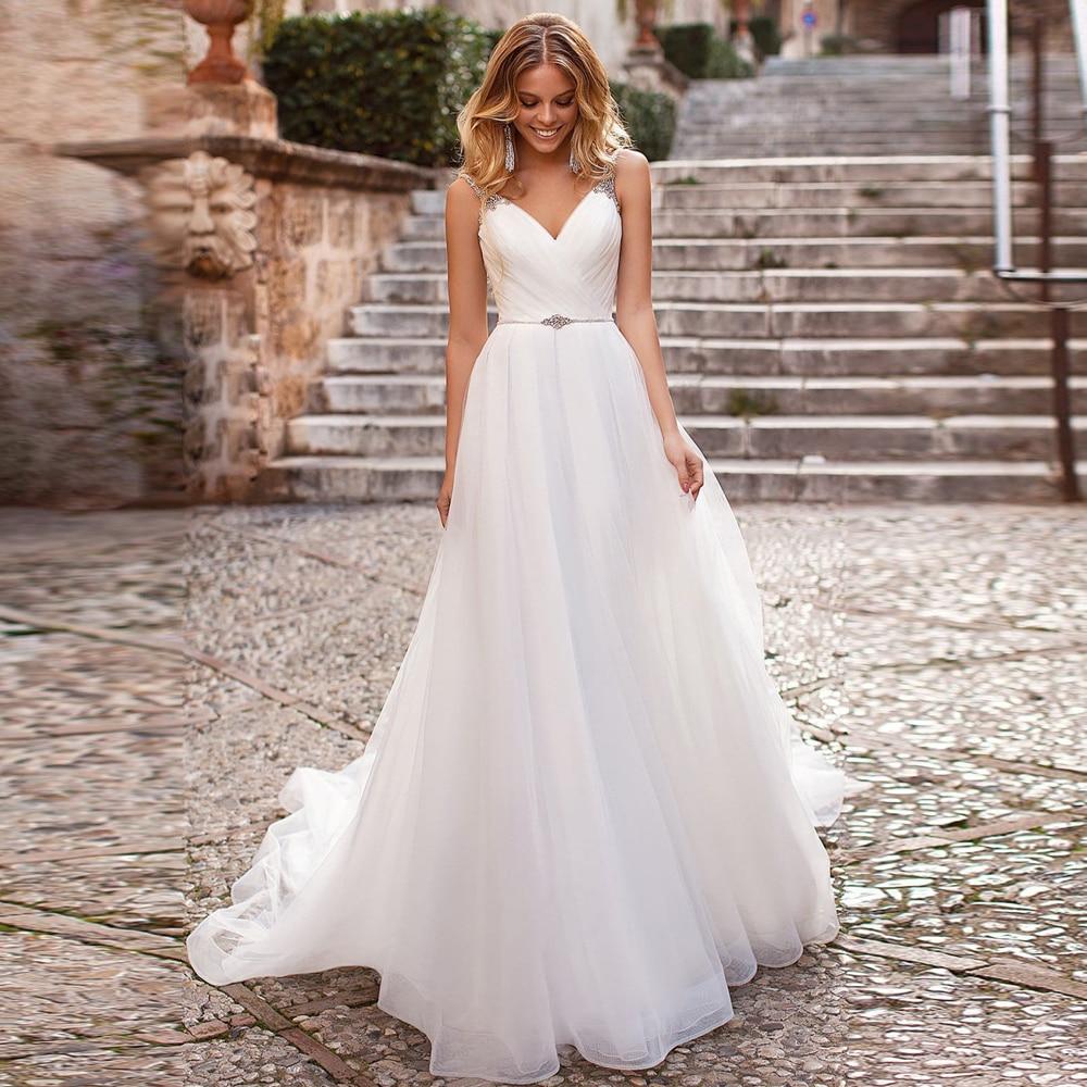 Charming Spaghetti Straps A-line Wedding Dresses With Rhinestones Robe De Mariee Custom Made Backless Organza Bridal Gown