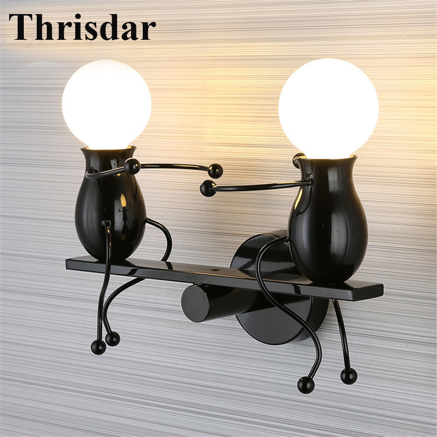 Thrisdar Modern Cartoon Doll LED Wall Lamp Creative Seesaw Iron Sconce Bedside Lamp For Kids Baby Bedroom Indoor Wall Sconces thrisdar e27 modern doll led wall light creative led mounted iron sconce wall lamp for kids baby room bedroom bedside hotel