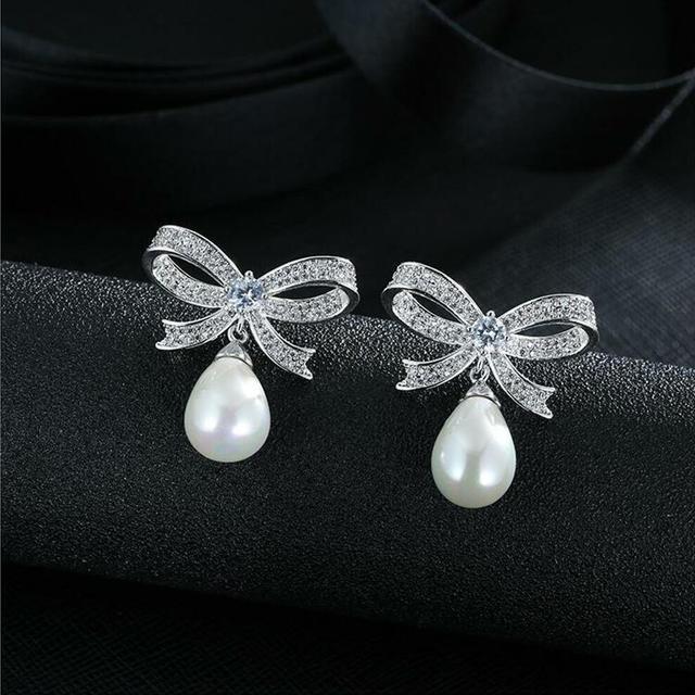 925 sterling silver ladies noble temperament earrings bow tie hanging water drops shell pearl earrings t0368