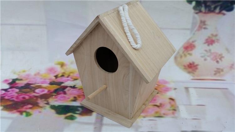 gaiola de reprodução do papagaio de madeira