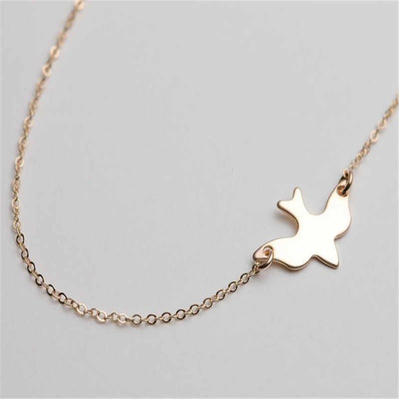Sprzedaż prosty styl złoty ptak naszyjnik łańcuszki sięgające obojczyka urok kobiet moda biżuteria gołąb pokoju wisiorek