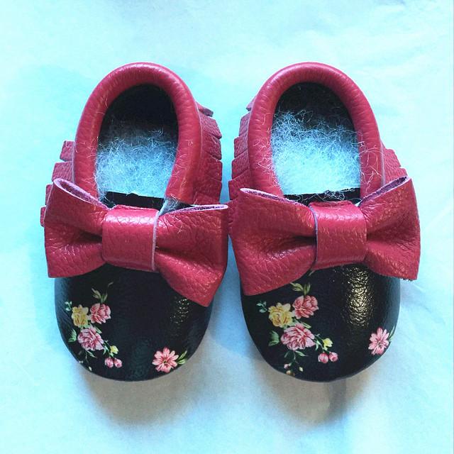 Moda primeros caminante cuero genuino Fringe del bebé del arco mocasines de impresión zapatos de bebé Bebe Chaussure zapatos recién nacidos