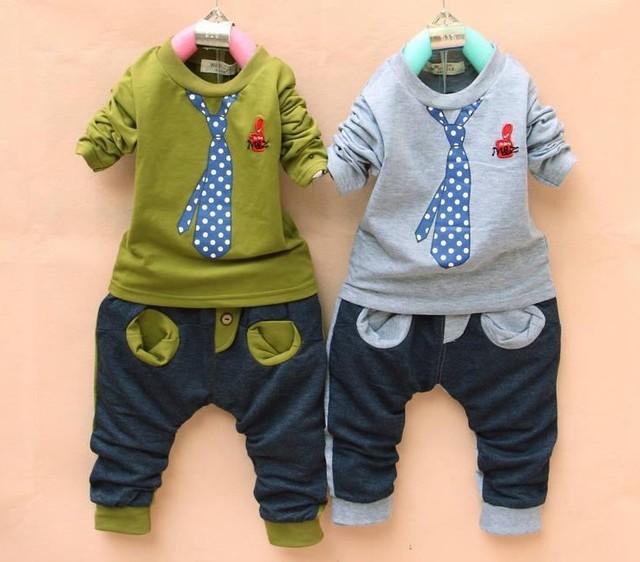 Súper ventas al por menor envío libre 2014 ropa de moda para los niños del bebé traje lazo falso set camiseta de manga larga + pantalones del juego del deporte
