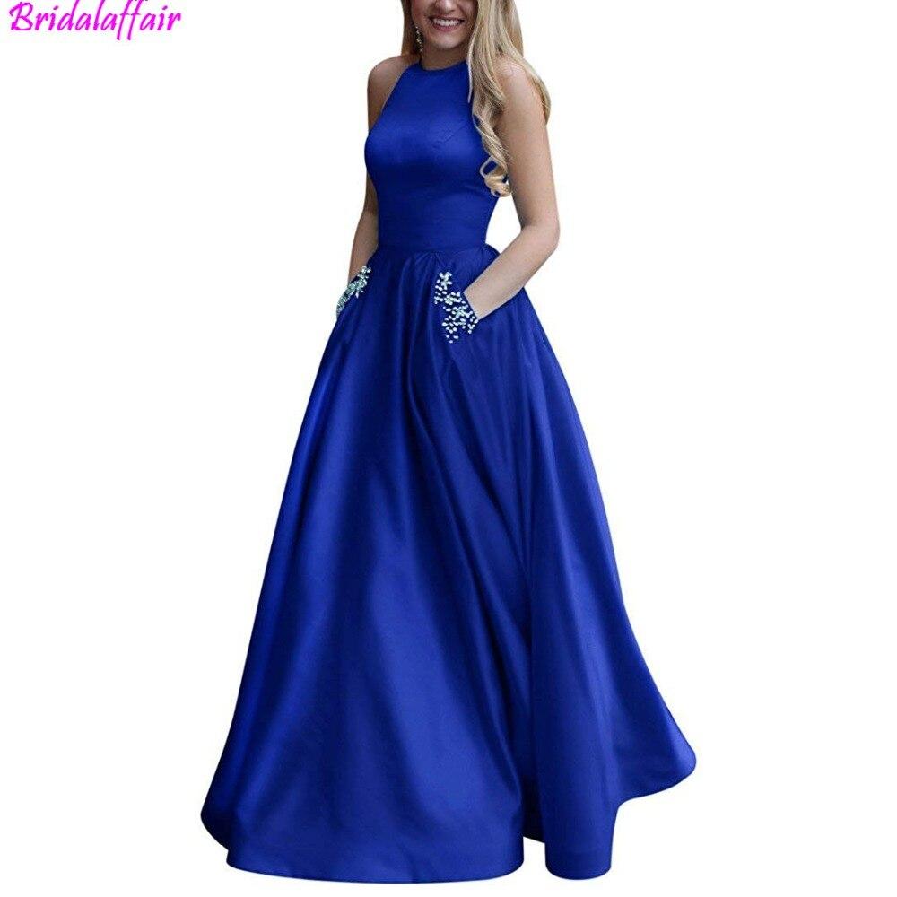 Femmes bleu royal de robe Perlée Halter Satin robe de bal Une Ligne Dos Ouvert robe de soirée Poches formelle robe longue robes de soirée