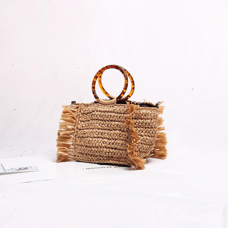 Woven bag female straw tassel amber round hand held 2019 new Korean version versatile holiday beach cross shoulder