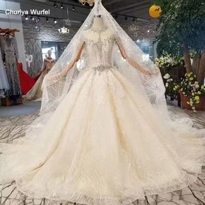 Image 1 - Ls11209 웨딩 베일 높은 목 캡 슬리브와 크리스탈 웨딩 드레스 기차 bruidsjurken 투명 웨딩 드레스