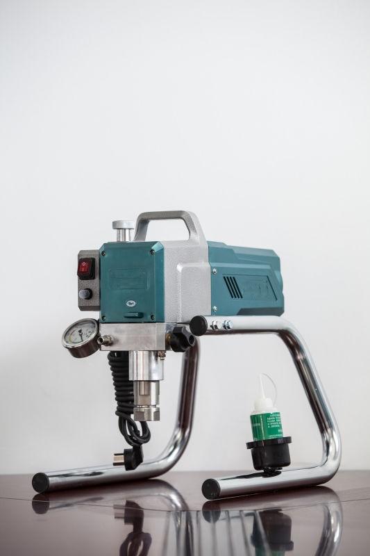 Pulverizador de pintura sin aire de bomba de diafragma con pistola de pulverización máquina de pintura de pistón Tipo de transporte portátil Spray sin aire
