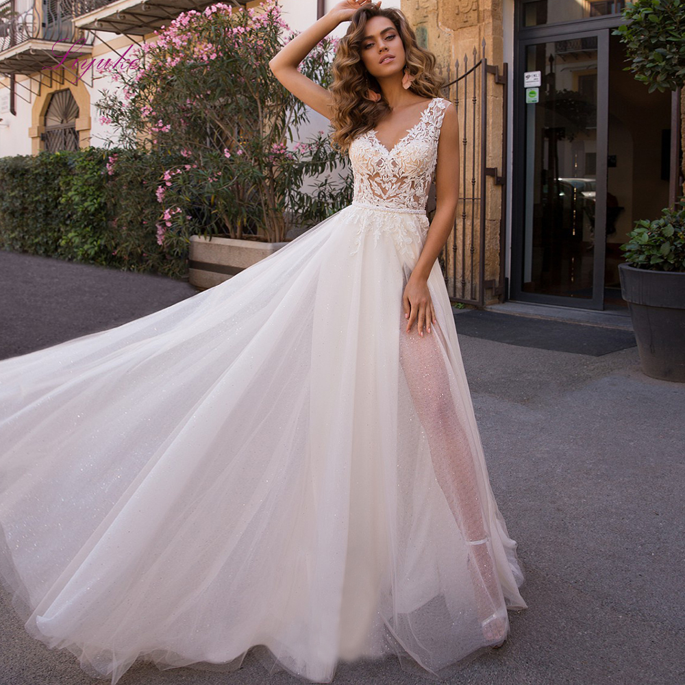 Liyuke 2019 Married Beach Wedding Dress Lace Appliques Cut-out V-neck Backless Illusion Sequins Tulle