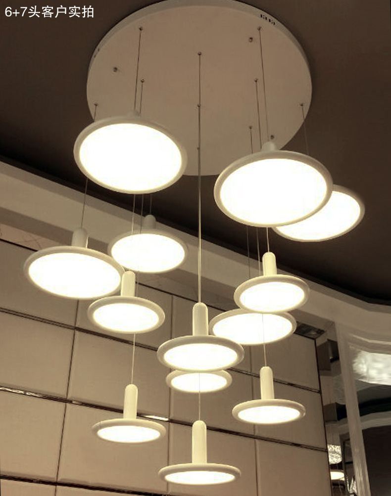 Modern minimalist white dining table creative nordic for Modern minimalist lighting