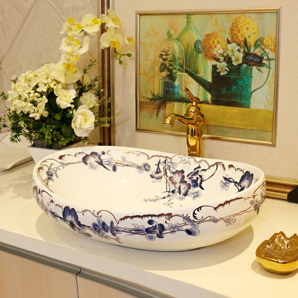 Haute qualité en céramique sanitaire lavabo art bassin Ovale Bleu Cloche Comptoir Lavabo Salle De Bains Éviers LO612532