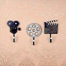 Foto Real personalidad creativa decorativa película de resina vintage tienda de ropa vestidor ganchos de pared de habitación ganchos de abrigo barra de café