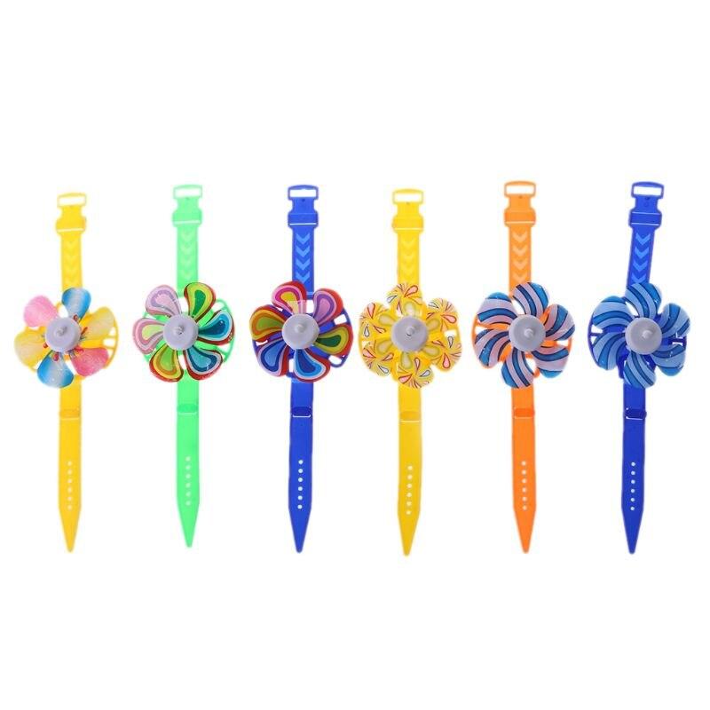 Nouveauté moulin à vent montre jouet montre vent Spinner enfants jouet fête fournitures cadeaux