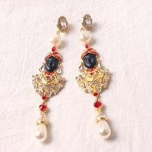 Moda cabras cara larga sección temperamento pendientes de perlas pendientes temperamento lleno de borrachos del muslo femenino 742