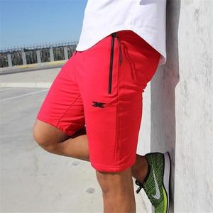 Image 1 - Pantalones cortos de algodón de alta calidad para hombre, Shorts informales de marca, a la moda, con bolsillos y cremallera, color rojo, para correr, para verano, 2019