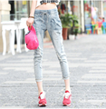 2015 New Hole Broken Jeans Female Elastic Waist Pants