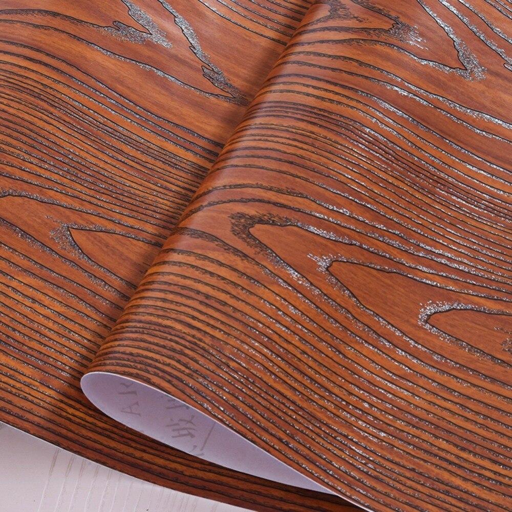 Automotive wood grain adhesive strip